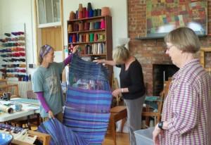 Students examining woven cloth